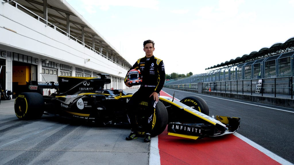 Lundgaard poses with the Renault F1 car in the pitlane at the Hungaroring